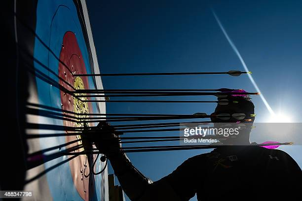 An archer check the target after shooting during the first day of the Archery test event for the Rio 2016 Olympic Games at Sapucai Sambodrome on...