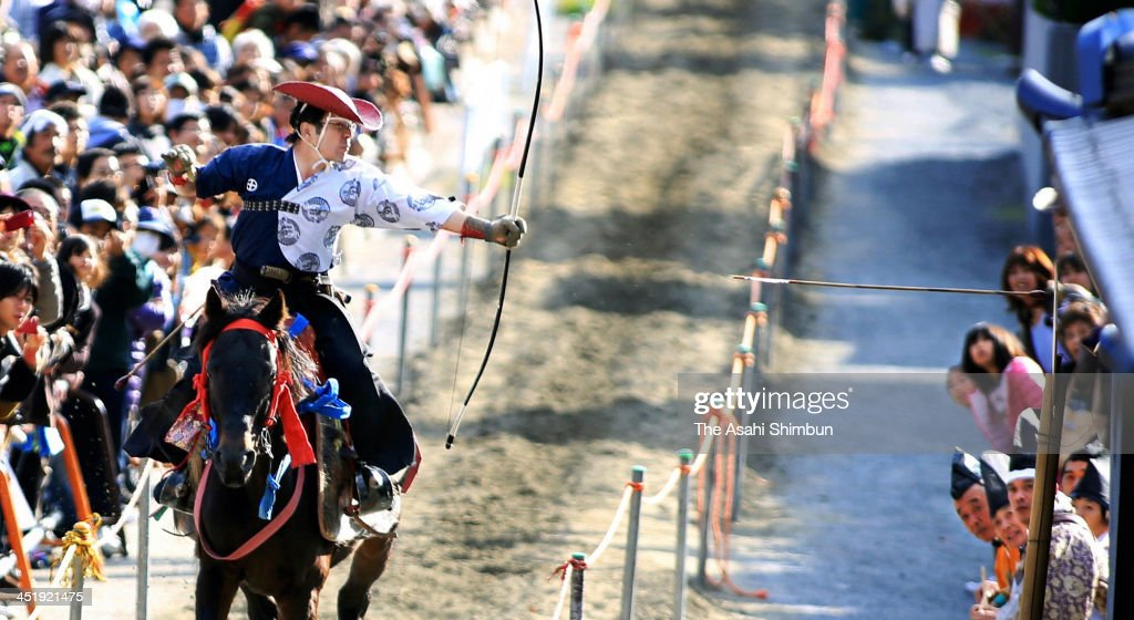 An archer on the running horseback aims at a target at Tado Taisha Shrine on November 23, 2013 in Kuwana, Mie, Japan. The annual event, attracts 25,000 visitors, is to appreciate for good hearvest.