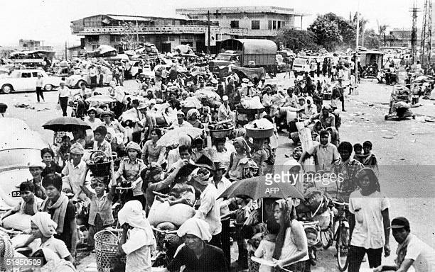An archive picture from Agence Khmere de Presse shows Cambodian people leaving Phnom Penh after Khmer Rouge forces seized and emptied the Cambodian...
