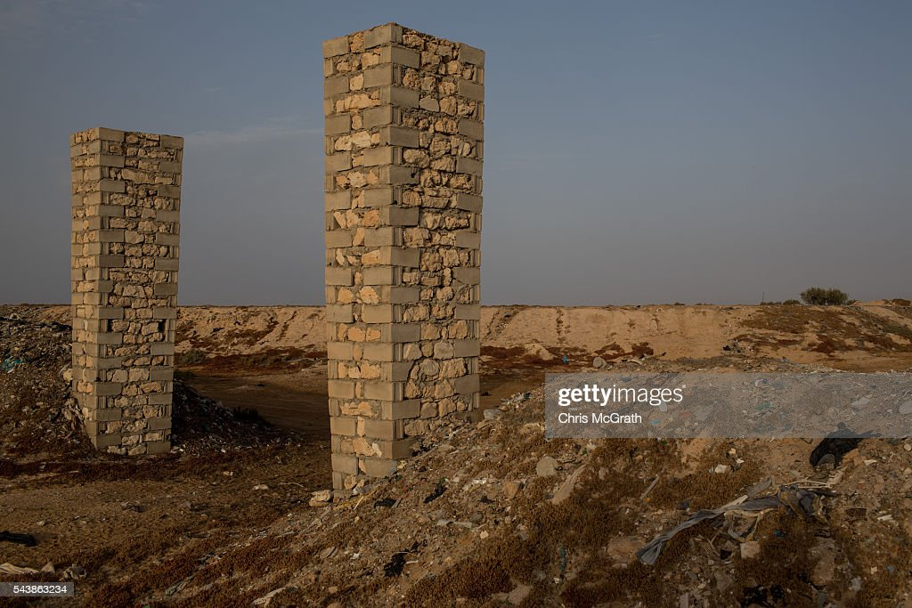 An area designated as a makeshift graveyard for migrants on the edges of a salt flat is seen on June 30, 2016 in Zarzis, Tunisia. The makeshift cemetary has an estimated 30 migrants buried in unmarked graves. Since 2012, the Tunisian border town of Zarzis has dealt with the overflow of migrants from Libya. In 2015 with pressure from EU nations, Tunisia tightened its border security with Libya, cutting the number of migrants arriving in Tunisian border towns. Local fishermen from the Zarzis port who were trained in rescue techniques by MSF in 2015 after being involved in weekly rescues, have seen no rescues so far in 2016, primarily due to an increase in rescue boats from international NGOÕs, coastguards and military vessels patrolling the waters off the Libyan coast. However with an estimated 800,000 migrants waiting in Libya to attempt the dangerous crossing to Europe, preparations were made for an expected increase in rescues and arrivals to Tunisia ahead of the 2016 peak season