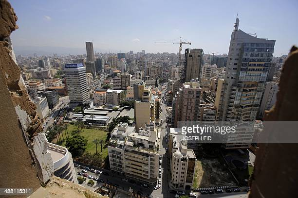 An area of West Beirut is seen through a window of the abandoned building of the Holiday Inn hotel in Beirut on April 11 2014 A symbol of Lebanon's...