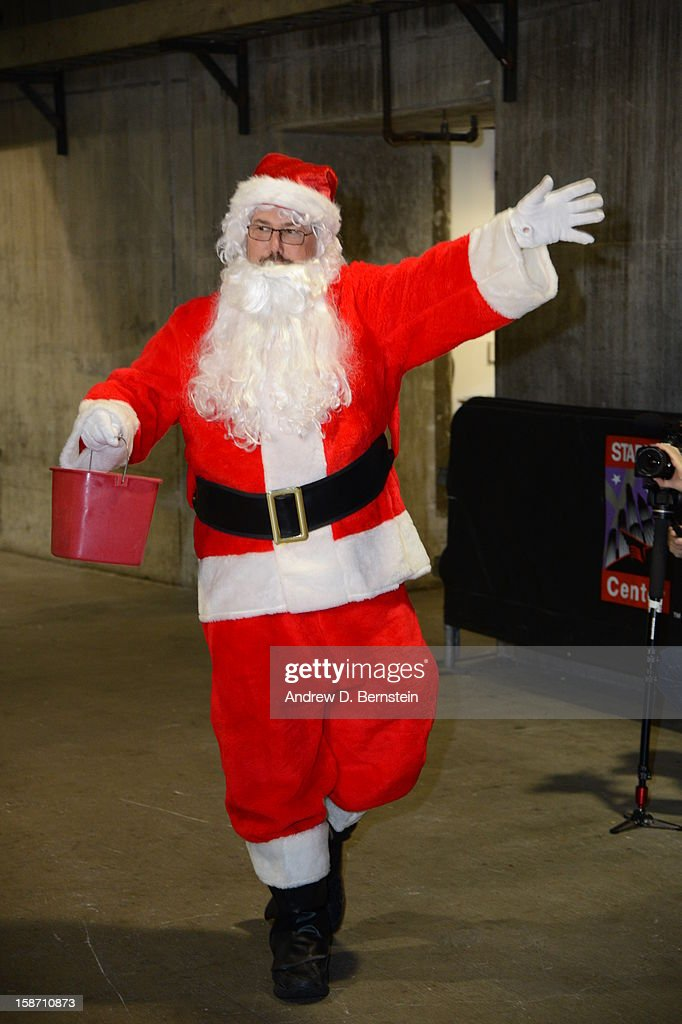 An arena employee dressed as Santa Claus walks in the hallway before a game between the New York Knicks and the Los Angeles Lakers at Staples Center on December 25, 2012 in Los Angeles, California.