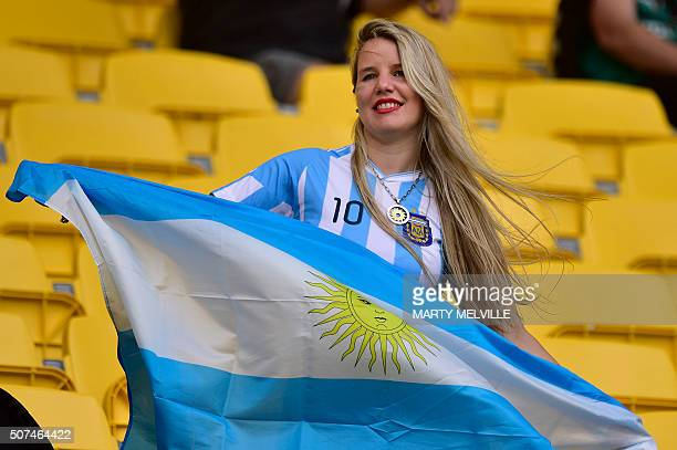An Argentina fan shows her support during pool play on the first day of the Wellington Sevens rugby union tournament at Westpac Stadium in Wellington...
