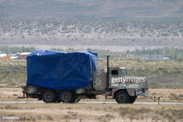 An Argentinian airforce truck transports Russian Navy's gear unloaded from the Antonov 124100 airplane to take part in the search and rescue mission...
