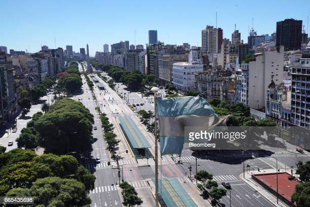 An Argentinian flag flies above empty streets during a national strike in Buenos Aires Argentina on April 6 2017 Argentina was brought to a...