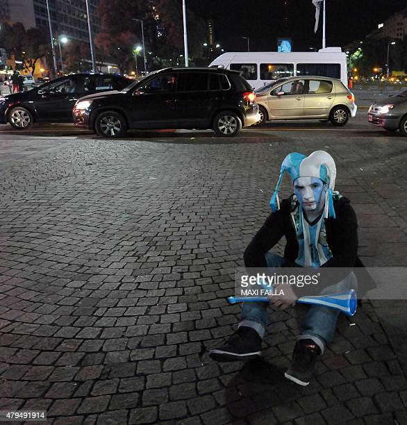 An Argentinian supporter shows his dejection after losing the 2015 Copa America final football match to Chile by penalty shootoutin Buenos Aires on...