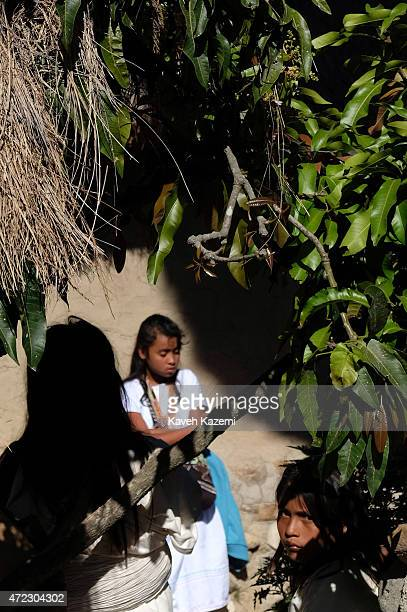 An Arhuaco girl looks at the camera seen inside the walled village also known as pueblito on January 24 2015 in Nabusimake Colombia Nabusimake is the...
