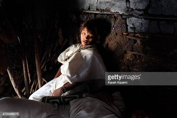An Arhuaco man under the influence of alcohol and use of Coca leaves seen in a hut in the walled village on January 23 2015 in Nabusimake Colombia...