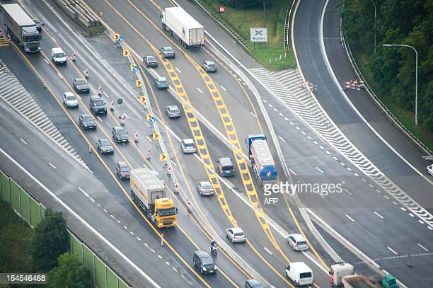 An arial view taken on June 21 2011 shows repair work on the Vilvoorde viaduct on the ring road in Brussels Major traffic jams are expected during...