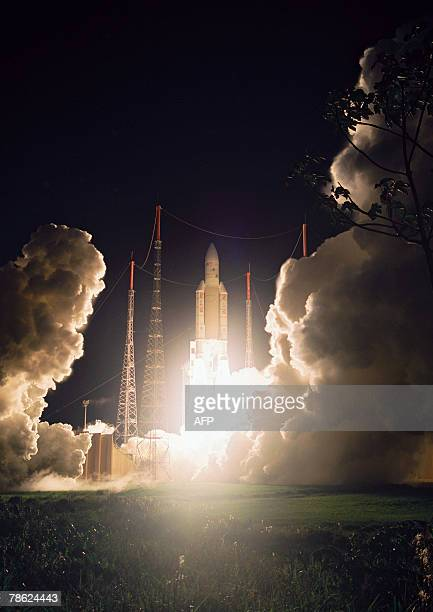 An Ariane 5 rocket blasts off 21 December 2007 in Kourou French Guiana This 180th launch put into orbit a RASCOMQAF1 telecommunications satellite for...