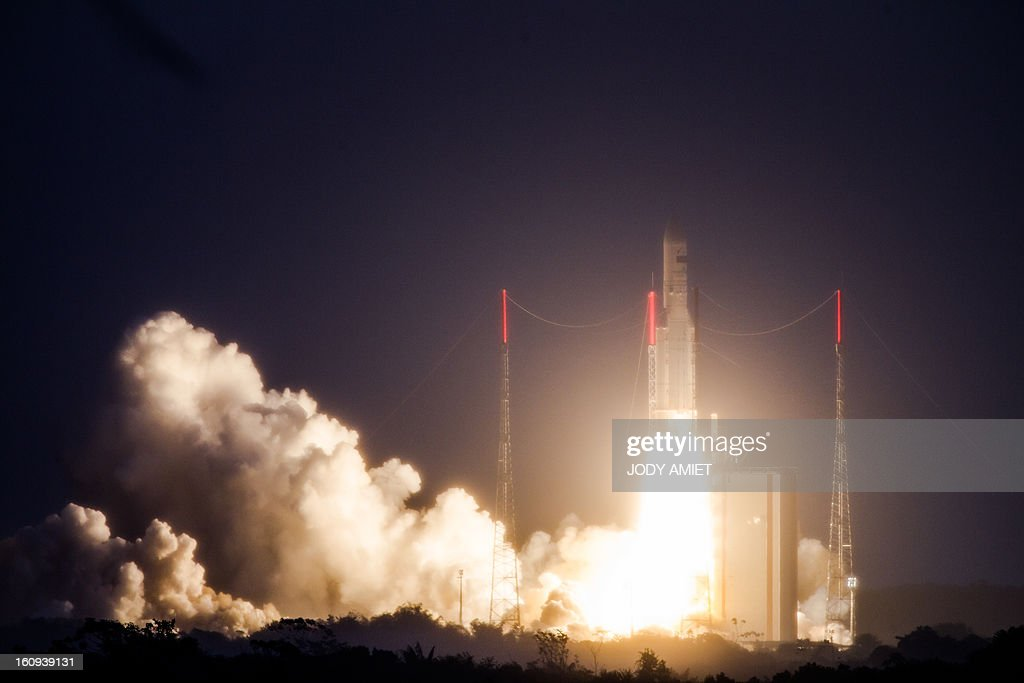 An Ariane 5 rocket carrying two satellites, Amazonas 3 and Azerspace/Africasat-1a, is pictured after blasting off on February 7, 2013 at the European space centre of Kourou, French Guiana.