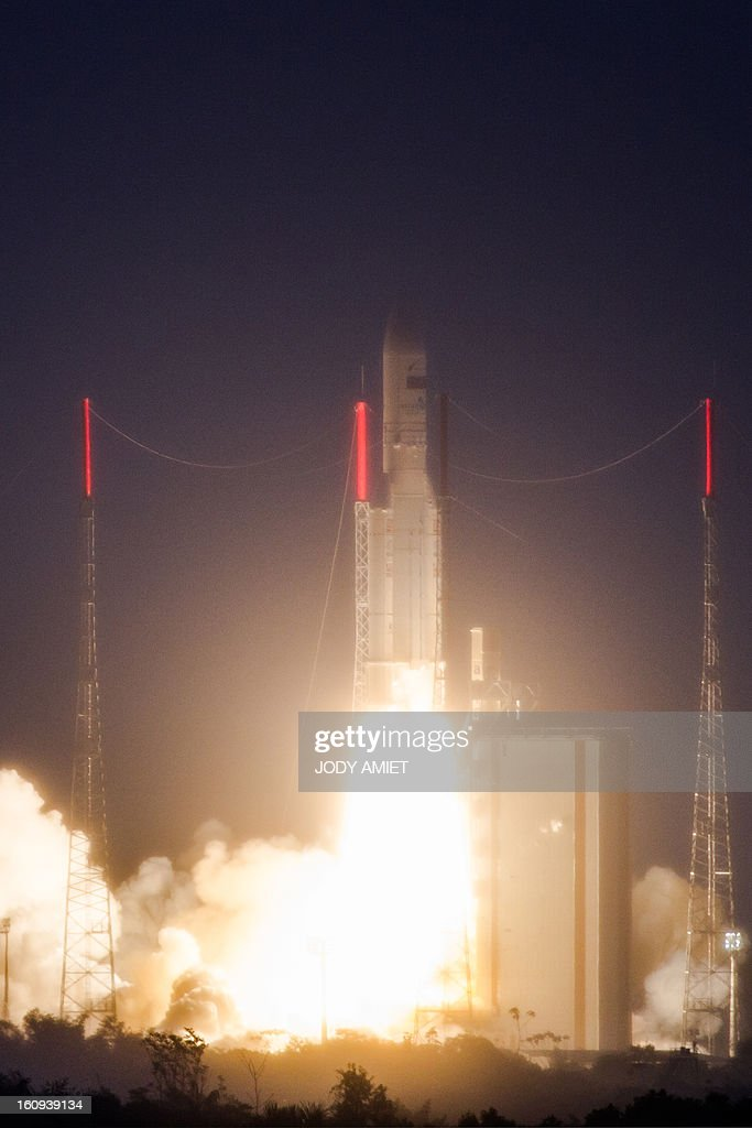 An Ariane 5 rocket carrying two satellites, Amazonas 3 and Azerspace/Africasat-1a, is pictured after blasting off on February 7, 2013 at the European space centre of Kourou, French Guiana. AFP PHOTO / JODY AMIET