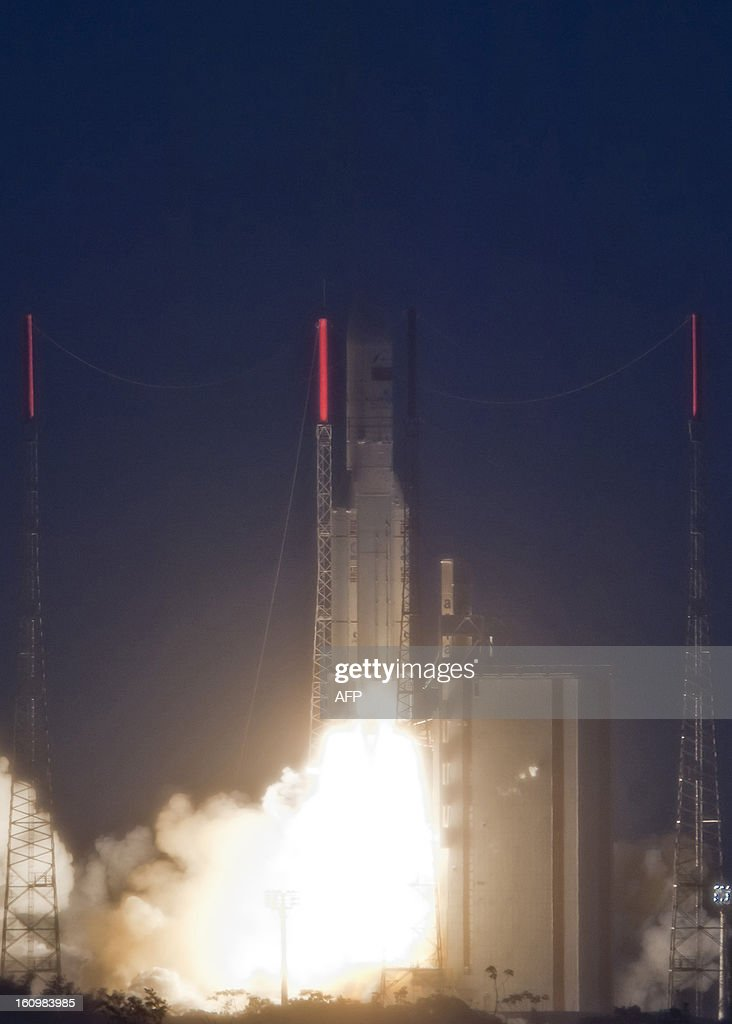 An Ariane 5 rocket carrying two satellites, Amazonas 3 and Azerspace/Africasat-1a, is pictured after blasting off on February 7, 2013 at the European space centre of Kourou, French Guiana. CLIENTS - .