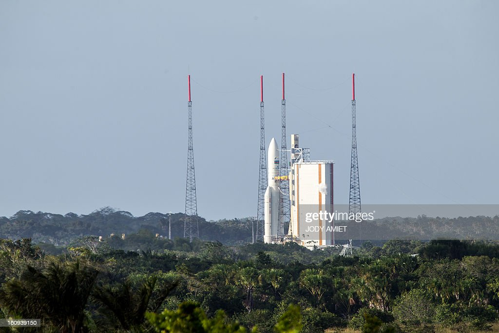 An Ariane 5 rocket carrying two satellites, Amazonas 3 and Azerspace/Africasat-1a, is pictured before blasting off on February 7, 2013 at the European space centre of Kourou, French Guiana. AFP PHOTO / JODY AMIET