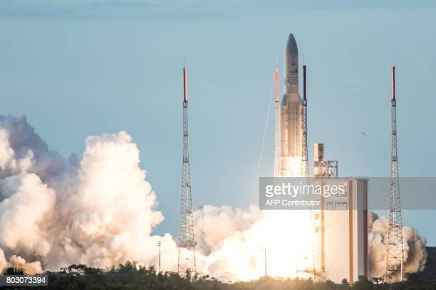 TOPSHOT An Ariane 5 rocket lifts off on June 28 2017 from the French Guiana Space Center in Kourou with HS3IS satellite and India's latest...