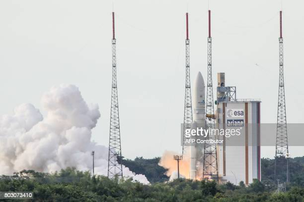 An Ariane 5 rocket lifts off on June 28 2017 from the French Guiana Space Center in Kourou with HS3IS satellite and India's latest communication...