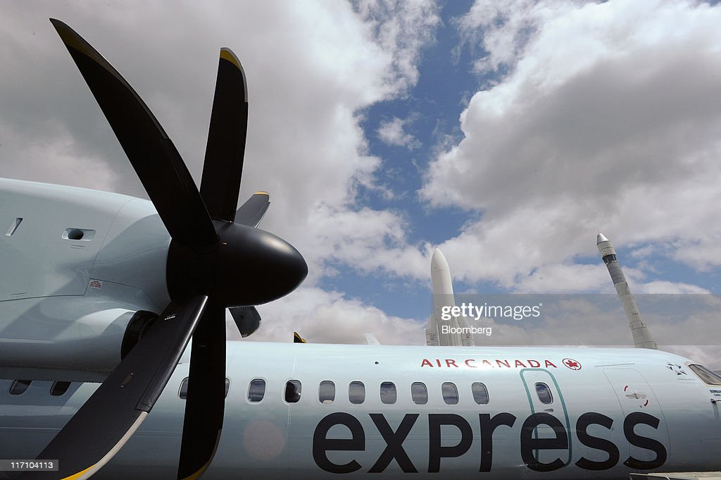 An Ariane rocket, center, is seen behind an Air Canada express aircraft at the Paris Air Show in Paris, France, on Wednesday, June 22, 2011. The 49th International Paris Air Show, the world's largest aviation and space industry show, takes place at Le Bourget airport June 20-26. Photographer: Fabrice Dimier/Bloomberg via Getty Images