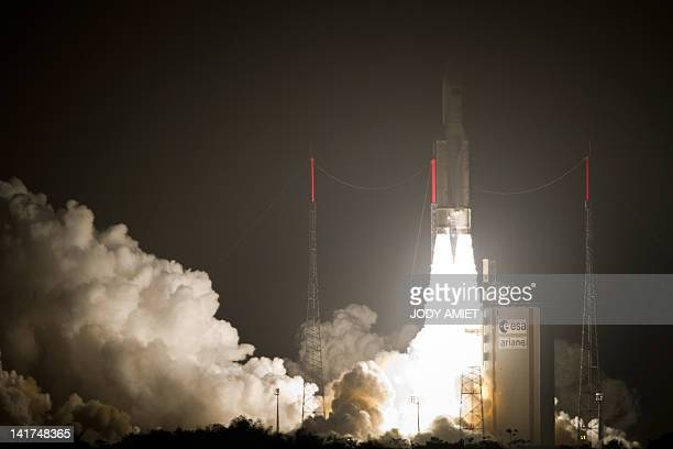 An Ariane5 rocket blasts off on March 23 2012 from the European space centre at Kourou French Guiana An automated craft laden with supplies for the...