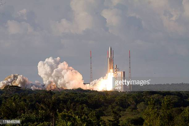An Ariane5 rocket carrying two telecommunication satellites Eutelsat 25B/ Eshail1 and GSAT7 blasts off from the European space centre of Kourou...