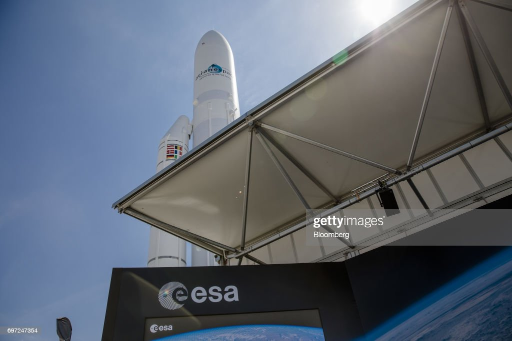 An Arianespace SA rocket stands beyond the European Space Agency (ESA) exhibition stand ahead of the 53rd International Paris Air Show at Le Bourget, in Paris, France, on Sunday, June 18, 2017. The show is the world's largest aviation and space industry exhibition and runs from June 19-25. Photographer: Marlene Awaad/Bloomberg via Getty Images