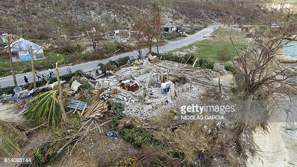 An ariel view shows a destroyed home in Port Salut southwest of PortauPrince on October 11 2016 Haiti faces a humanitarian crisis that requires a...