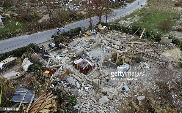 TOPSHOT An ariel view shows a destroyed home in Port Salut southwest of PortauPrince on October 11 2016 Haiti faces a humanitarian crisis that...