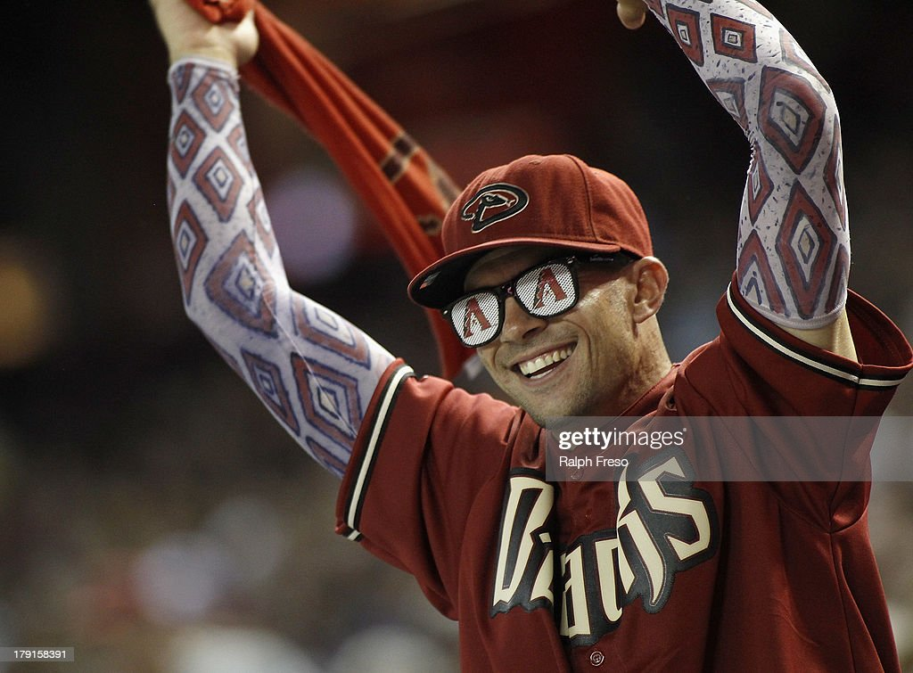 An Arizona Diamondbacks fan celebrates the team's 4-3 victory over the San Francisco Giants during a MLB game at Chase Field on August 31, 2013 in Phoenix, Arizona.