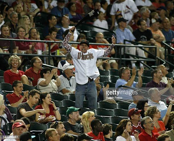 An Arizona Diamondbacks fan tries to energize the home crowd during a MLB game against the St Louis Cardinals at Chase Field on May 7 2012 in Phoenix...