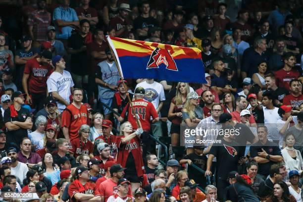An Arizona Diamondbacks fan waves a flag during the MLB National League Wild Card baseball game between the Colorado Rockies and the Arizona...