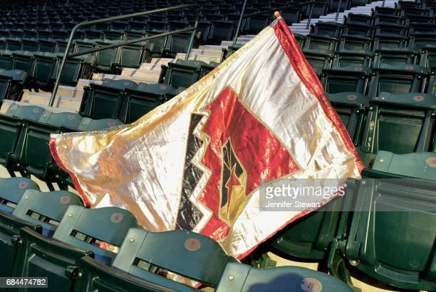 An Arizona Diamondbacks flag lays on the stadium chairs during the MLB game between the Cleveland Indians and Arizona Diamondbacks at Chase Field on...