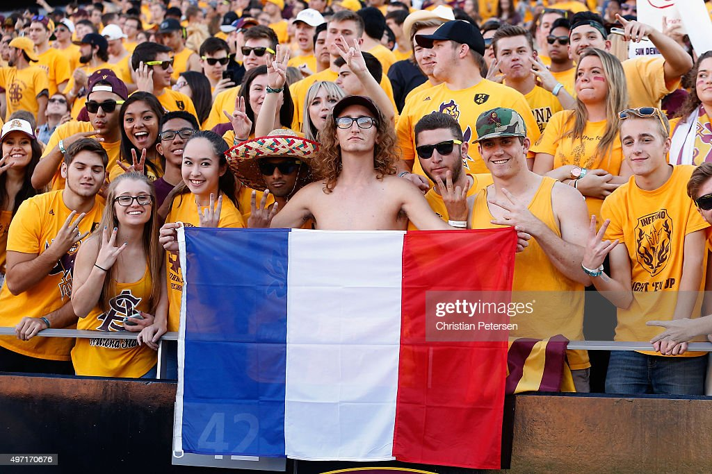 An Arizona State Sun Devils student holds a French flag during the college football game against the Washington Huskies at Sun Devil Stadium on...