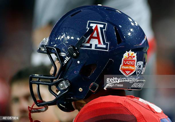 An Arizona Wildcat player looks on from the sideline during the Vizio Fiesta Bowl game against the Boise State Broncos at University of Phoenix...