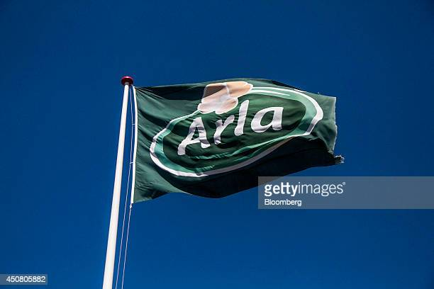 An Arla branded flag flies at the Arla Foods amba butter factory in Holstebro Denmark on Tuesday June 17 2014 Arla Foods the world's largest producer...