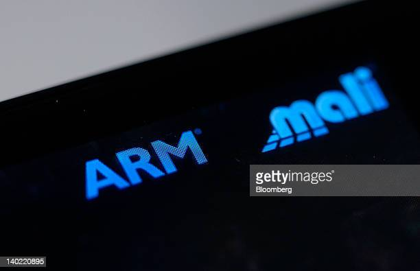 An Arm Holdings Plc logo and a Mali graphics processor logo are displayed on the screen of a mobile device at the Mobile World Congress in Barcelona...