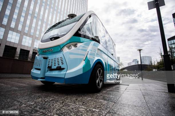 An Arma autonomous shuttle bus manufactured by Navya Technologies SAS travels in La Defense business district of Paris France on Wednesday July 19...