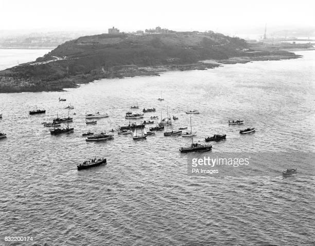 An 'armada' of small boats heroworshipping roundtheworld yachtsman Robin KnoxJohnston in his 32ft ketch Suhaili