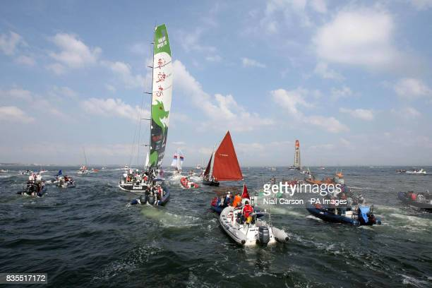 An armada of small craft follow the Green Dragon back to port after the inshore racing event on then second weekend of the Volvo Ocean Race in Galway