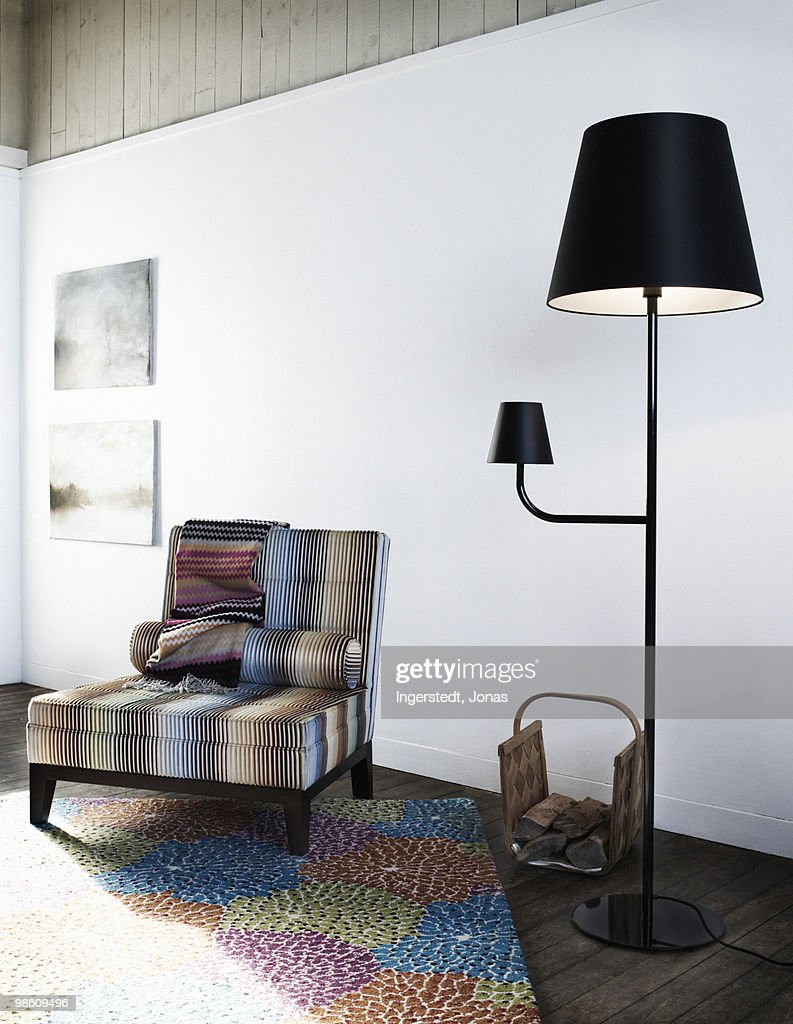 An armchair and a black standard lamp, Sweden. : Stock Photo