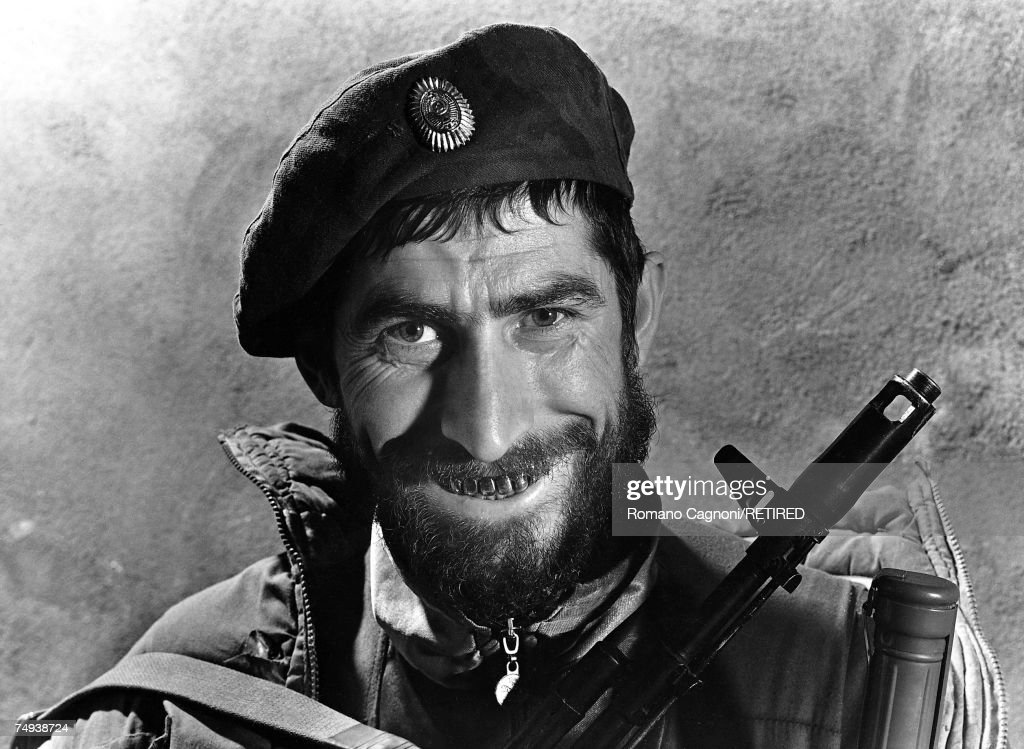 An armed Chechen separatist fighter displays a row of gold teeth during the First Chechen War, Chechnya, 1995.