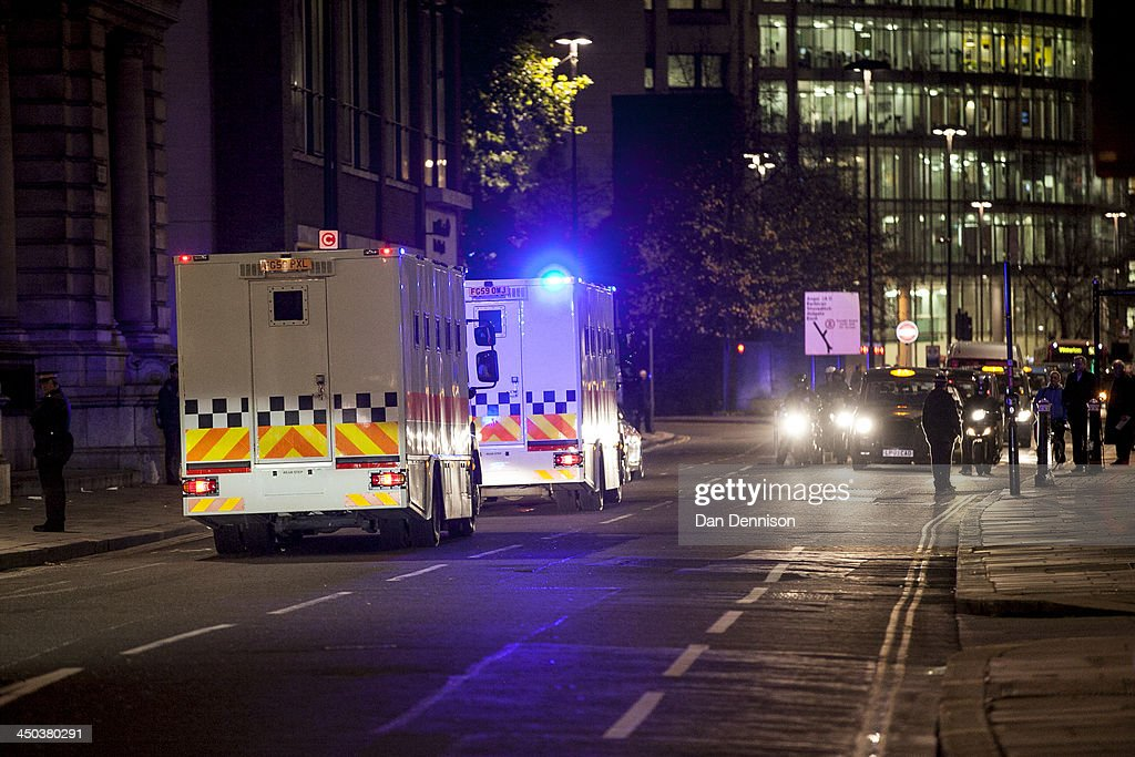 An armed City of London Police convoy escorts prison vans during the trial of Michael Adebolajo and Michael Adebowale at the Old Bailey on November...