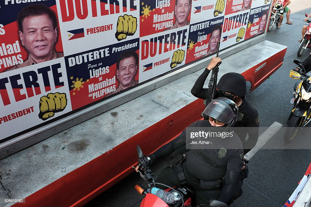 An armed escort accompanies presidential candidate <a gi-track='captionPersonalityLinkClicked' href=/galleries/search?phrase=Rodrigo+Duterte&family=editorial&specificpeople=15240619 ng-click='$event.stopPropagation()'>Rodrigo Duterte</a> while he campaigns on May 1, 2016 in Manila, Philippines. Duterte, the tough-talking mayor of Davao in Mindanao has been the surprise pre-election poll favorite, pulling away from his rivals despite controversial speeches and little national government experience. Opinion polls have shown Mr. Duterte has maintained his lead with 33 percent support, with Senator Grace receiving 22 percent. The Philippine presidential elections will be held on May 9, with five candidates vying for the top post.