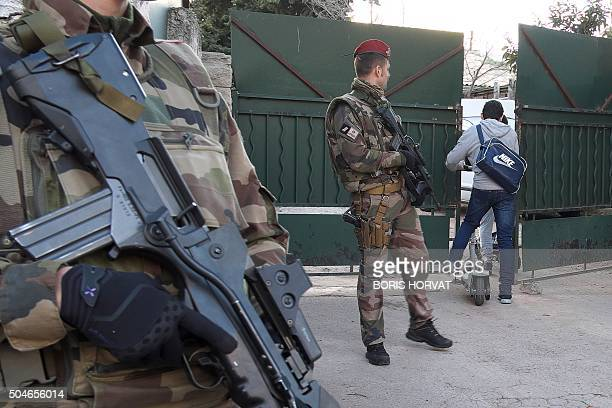 An armed French soldiers secures the access to the 'La Source' Jewish school in Marseille southern France on January 12 a day after a teenager armed...