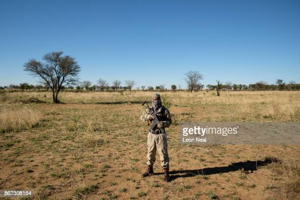 An armed guard patrols the area at the ranch of rhino breeder John Hume on October 16 2017 in the North West Province of South Africa John Hume is...