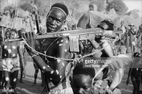An armed man attends the 'sibar' or harvest festival at Shatt Dammam in the Nuba Mountains of Kordofan in central Sudan 5th December 1995