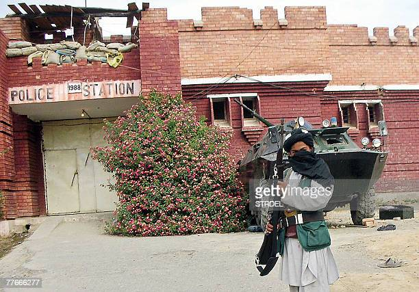 An armed Pakistani militant loyal to proTaliban cleric Mullah Fazlullah stands outside a police station at Matta in Swat district 03 November 2007...