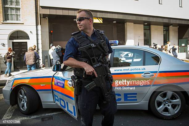 An armed police officer blocks the street as men charged with plotting the Hatton Garden jewellery heist arrive at Westminster Magistrates' Court on...