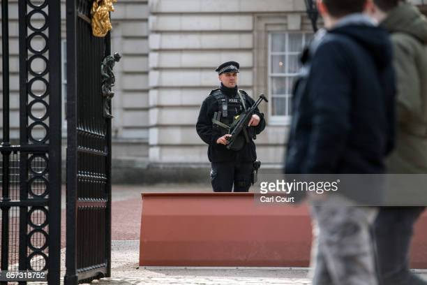 An armed police officer guards Buckingham Palace on March 24 2017 in London England A fourth person has died after Khalid Masood drove a car into...