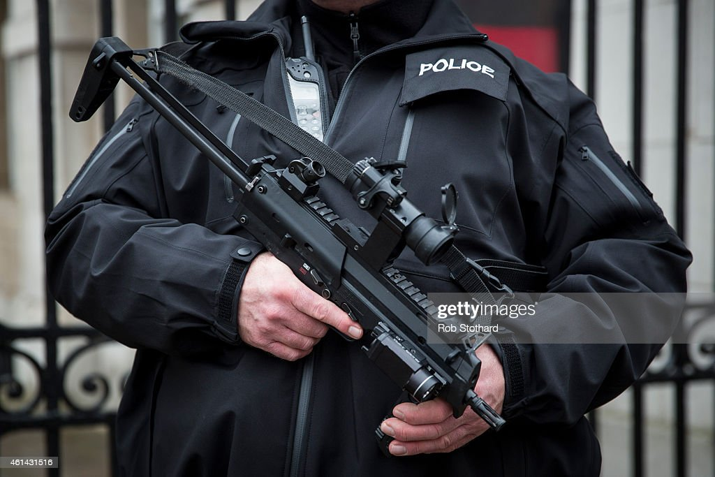 An armed police officer patrols on Whitehall on January 12 2015 in London England Prime Minister David Cameron and security chiefs met earlier today...