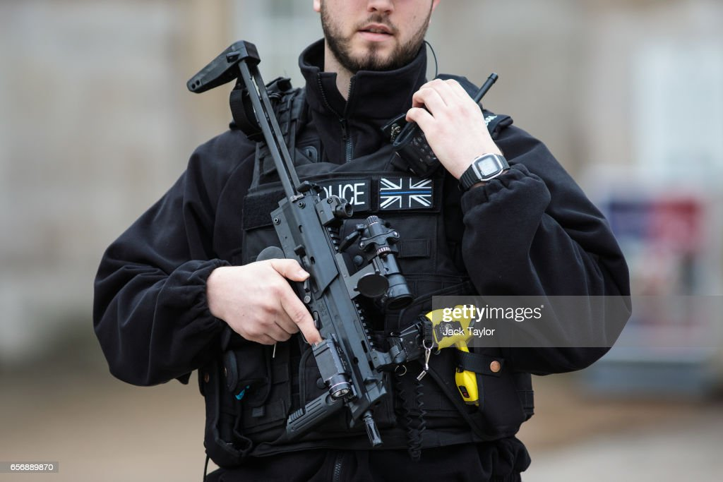An armed police officer stands guard on Whitehall following yesterday's attack in which one police officer was killed on March 23, 2017 in London, England. Four people have been killed and around 40 people injured following yesterday's attack by the Houses of Parliament in Westminster.