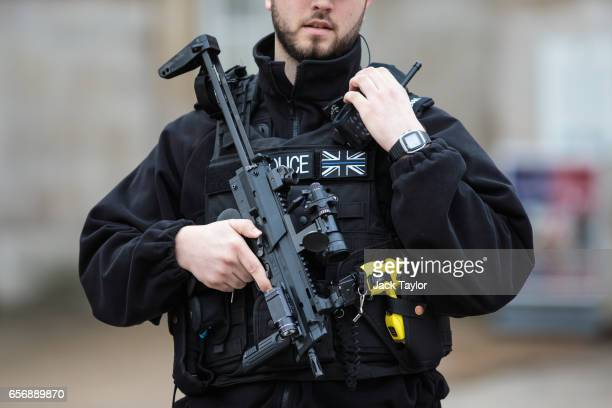 An armed police officer stands guard on Whitehall following yesterday's attack in which one police officer was killed on March 23 2017 in London...
